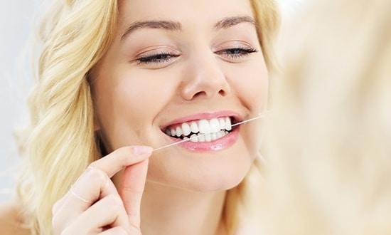 Patient flossing teeth Bristol